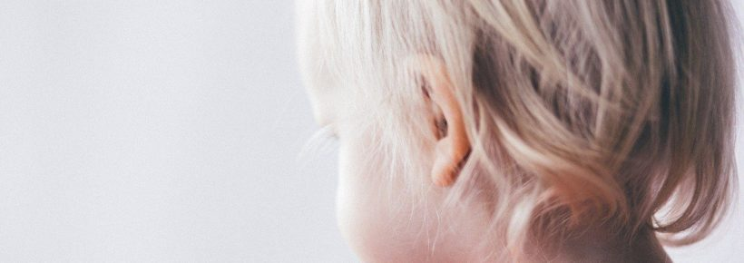 blond baby girl toddler from the back