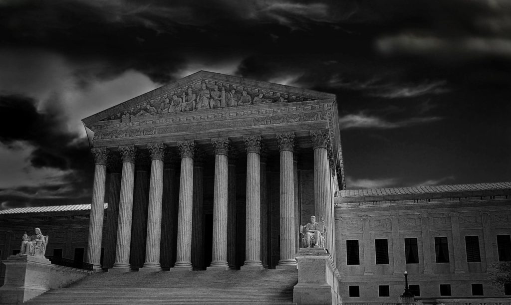 The US Supreme Court in Washington DC with dark storm clouds