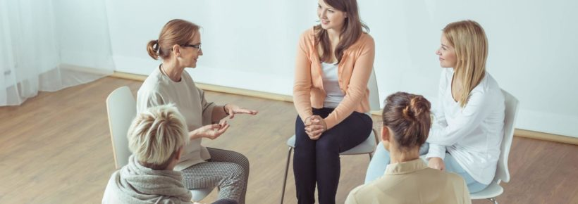 women meeting talking in support group - infertility support groups
